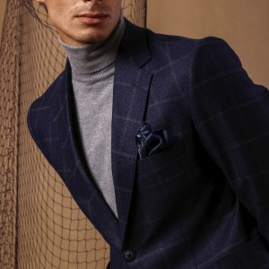 The dark navy notch lapel jacket crafted of wool fabrics
